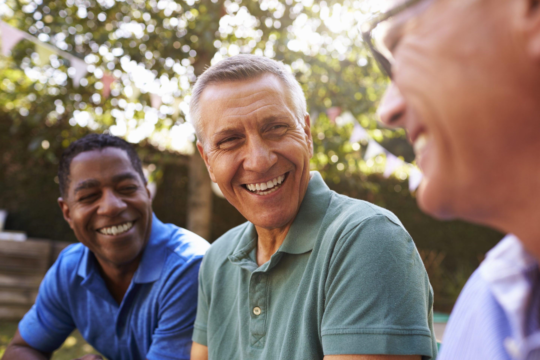 Mature Male Friends Socializing In Backyard Together | SLENT