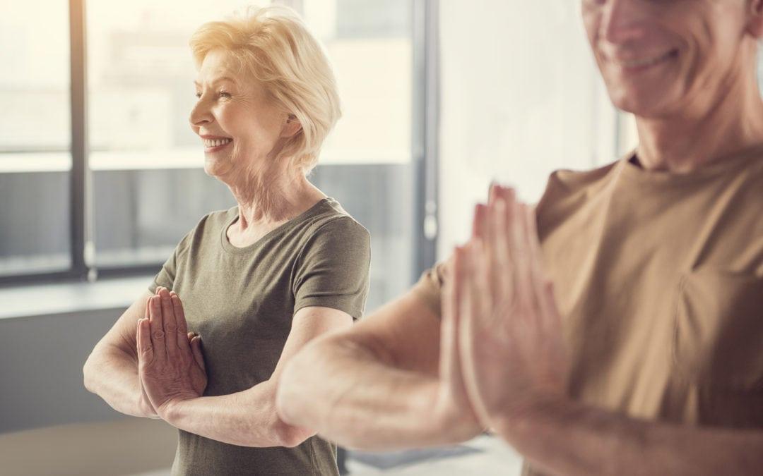 Peaceful retirees attending yoga classes | SLENT